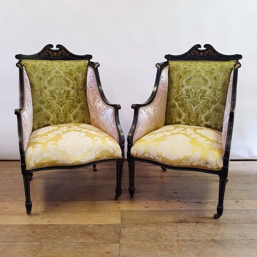 A pair of early 20th century ebonised and marquetry inlaid a...