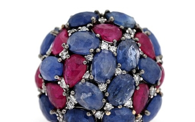 NOT SOLD. A sapphire and ruby ring set with numerous sapphires, rubies and diamonds, mounted...