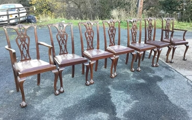 A set of seven Chippendale style mahogany dining chairs...