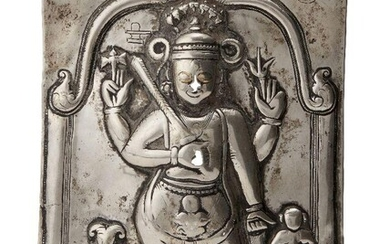 A silver repousse plaque of Shiva, South India, 19th century,...