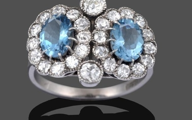 An Aquamarine and Diamond Double Cluster Ring, two oval cut...