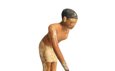 An Egyptian painted wood servant figure