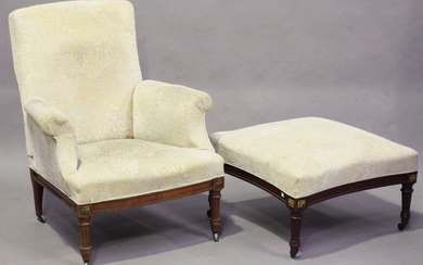 An early/mid-20th century French walnut framed reclining armchair with gilt metal mounts and fluted