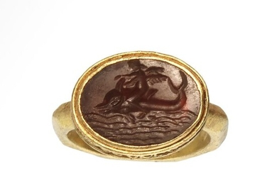 Ancient Roman Gold and Cornelian Intaglio Ring with Cupid Eros Riding a Dolphin