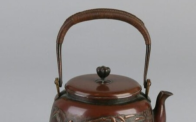 Antique Chinese copper kettle with bamboo decor and