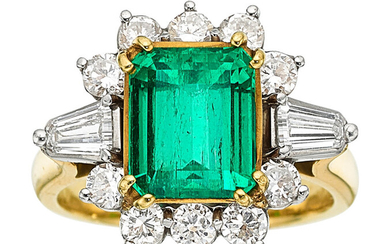 Emerald, Diamond, Platinum, Gold Ring The ring features an...