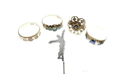 Four assorted gold and yellow metal rings comprising 18ct...