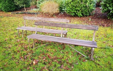 Garden seats: A pair of wrought iron and wooden slatted seats