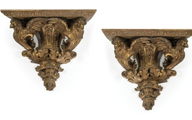Pair of carved, stuccoed and gilded wood sconces formed by a sheath of foliage in the centre, extended at the ends by two protruding rooster protomés with spread wings, which hold the shelf edged with a foliated frieze.