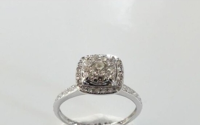 RING in 750°/°° white gold decorated with a 0ct25 approx....