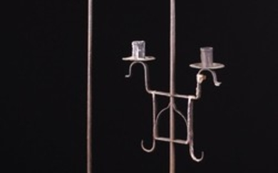 Two Similar Wrought Iron Floor Standard twin-socket Candle Holders; one 18th century, the other late