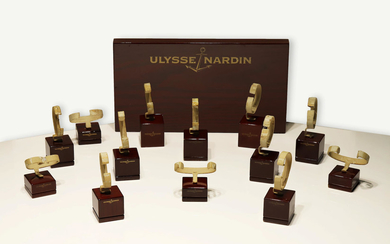 Ulysse Nardin. An Attractive Wood Display and Thirteen Watch Display Stands