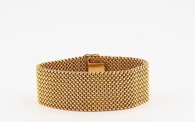 Yellow gold (585) ribbon bracelet with braided mesh....