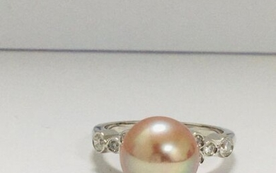 14ct White Gold Pearl and Diamond ring featuring...
