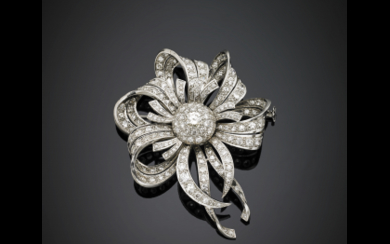 Round diamond flower and volute white gold brooch, with...