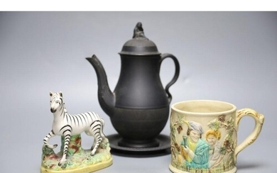 A 19th century Staffordshire pottery model of a zebra, a Vic...