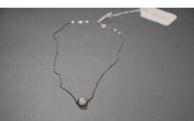 A 750 white metal and diamond set ball pendant necklace, pen...