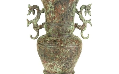 A CHINESE ARCHAIC FORM VASE Twin dragon handles with embosse...