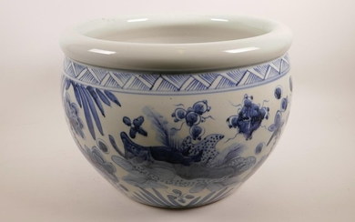 A Chinese blue and white pottery jardiniere decorated with c...