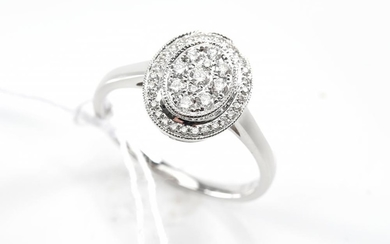 A DIAMOND DRESS RING - Featuring an oval plaque set with forty one round brilliant cut diamonds totalling 0.31ct, in 18ct white gold...