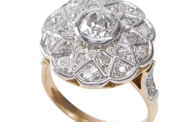 A DIAMOND RING-Of cluster design, centrally set with an old European cut diamond weighing 0.67cts, surrounded and shouldered by mixe...
