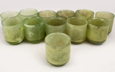 A GOOD SET OF TWELVE CHINESE CARVED GREEN JADE WINE