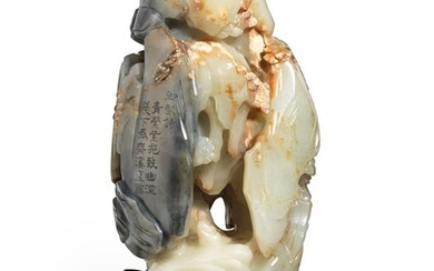 A GREENISH-WHITE AND GREY JADE 'LUOHAN AND GROTTO' GROUP