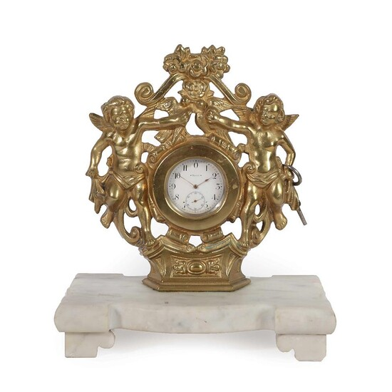 A Gilt Metal Desk Timepiece, early 20th century, gilt metal...