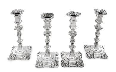 A Group of Four English Silver-Plate Candlesticks