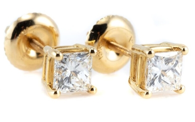 A PAIR OF SOLITAIRE DIAMOND STUD EARRINGS; each set with a princess cut diamond in 18ct gold, diamonds total 0.90ct, H/VS.