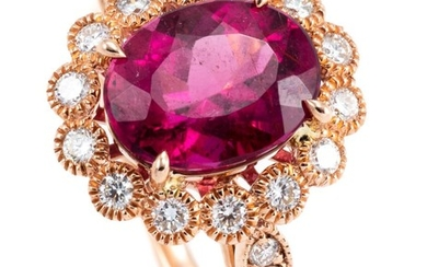 A ROSE GOLD PINK TOURMALINE AND DIAMOND CLUSTER RING; centring a 2.53ct rubellite to surround and shoulders set with 18 round brilli...
