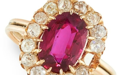 A RUBY AND DIAMOND CLUSTER RING in yellow gold, set