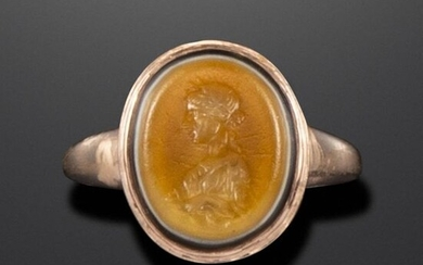 A Roman sardonyx intaglio depicting Salus, c1st century BC - 1st century AD, the bust depicted in profile with a snake below, in a later gold ring mount, with maker~s mark SP, intaglio 1.3cm high, ring size R 1/2 Salus was the ancient Roman goddess of...
