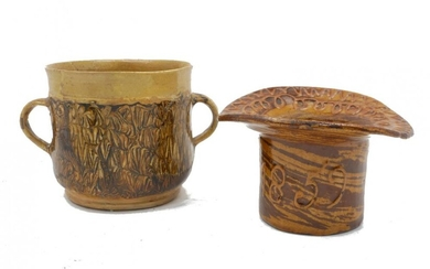 A Staffordshire twin handled cup, decorated with...