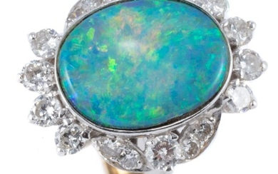 A TWO TONE 18CT GOLD OPAL AND DIAMOND RING; centring an approx. 3.66ct (13.2 x 10.7mm) boulder opal with good colour range surrounde...