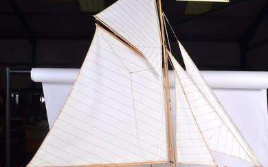 A VINTAGE POND YACHT, with associated wooden stand.