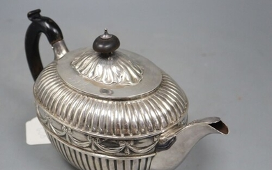 A Victorian fluted silver oval teapot by William Hunter, Lon...