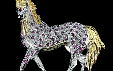 A brooch in the shape of a horse set with numerous circular-cut rubies, mounted in rhodium and gold plated sterling silver. App. 40×45 mm.