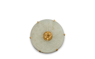 A carved jade bi disc in a gilt metal mount
