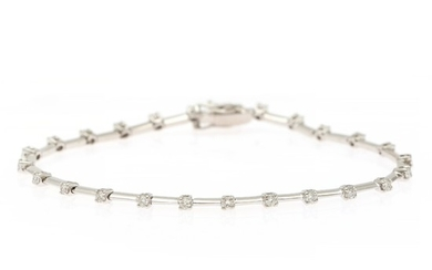 A diamond bracelet set with numerous brilliant-cut diamonds totalling app. 0.83 ct., mounted in 18k white gold. L. 17.8 cm.