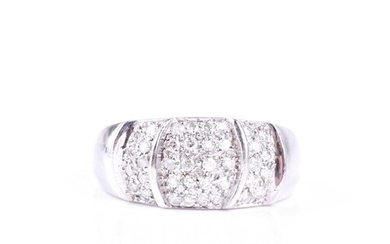 A diamond set dress ring, the wide convex 9ct white gold ban...