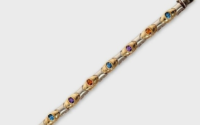 A gem-set fourteen karat bi-color gold strap bracelet