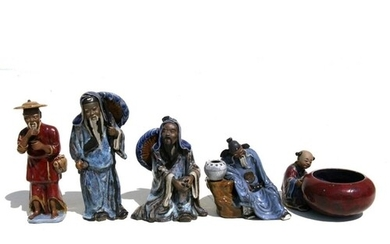 A group of Chinese glazed pottery figures, the largest 22cms...