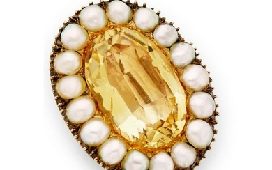 A mid 19th century foil back topaz and pearl brooch.