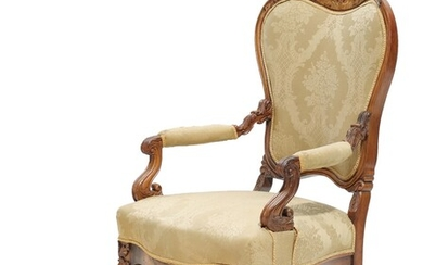 A mid 19th century rosewood Napoleon III armchair with brass and mother of pearl inlays.