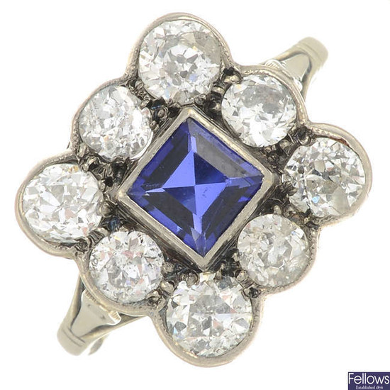 A mid 20th century synthetic sapphire and old-cut diamond cluster ring.