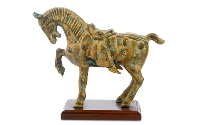A modern patinated metal horse figure, modelled in the manner of a Tang Dynasty Chinese horse