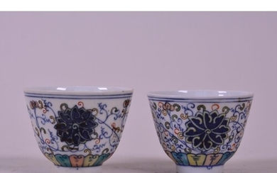 A pair of Chinese doucai porcelain tea bowls with lotus flow...