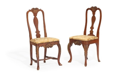 A pair of Danish 18th century partly gilded beech wood Baroque chairs. (2)