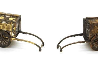 A pair of Japanese sterling silver and silver gilt miniature rickshaws
